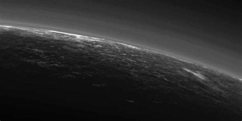 New Pluto Image Could Show White CLOUDS Drifting Over The
